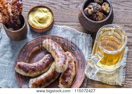 Grilled Sausages With Fried Bacon Rashers And Mushrooms