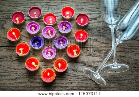 Burning Candles In The Shape Of Heart With Two Flutes