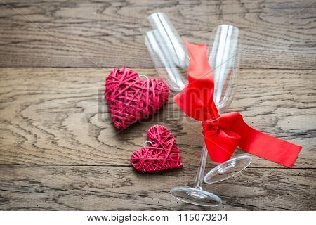 Two Flutes With Retro Cane Hearts On The Wooden Background