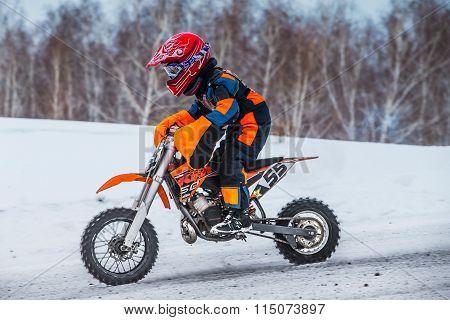 closeup little boy racers on motorcycle