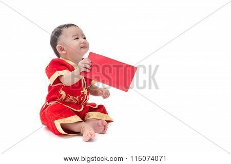 Cute Asian Baby In Traditional Chinese Suit With Red Pocket, Isolated On White Background