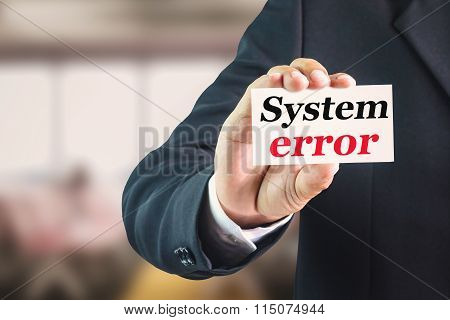 Businessman holding a white sign with the message system error.