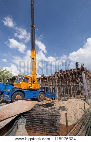 Worker Casting Concrete Slab With Mobile Crane To Build A House