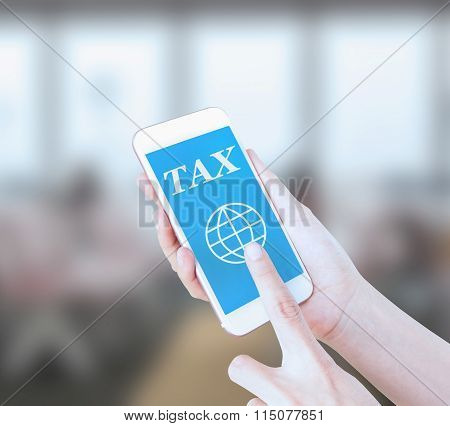 Mobile touch screen phone with text TAX on the screen