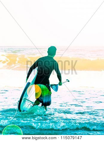 Surfer Holding A Surfboard On The Beach