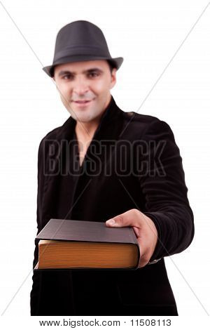 Happy Man Standing  Offering A Book, Isolated On White, Studio Shot
