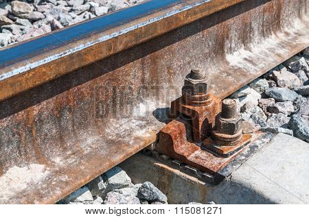 Railroad Nut And Bolt On Background Of Gravel