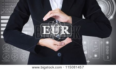 Business women holding posts in EUR.