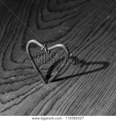 Two nails forming a shape of heart