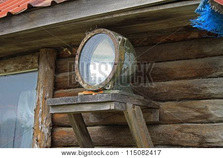 Old searchlight mounted on a wooden house