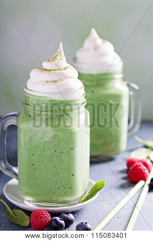 Green smoothie with whipped topping