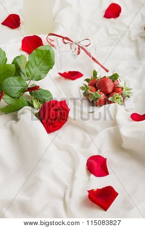 Rose, Wine,  Petals And Strawberry On Bed