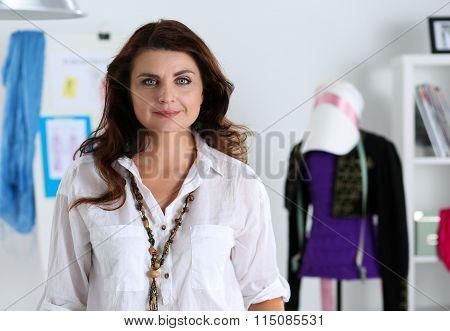Female Fashion Designer Standing In Workshop Portrait