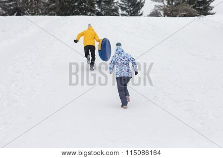 Young Happy Couple Walking In Winter Park