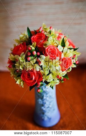 Wedding Bridal Bouquet Of Yellow And Red In A Vase