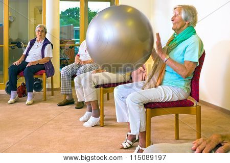Elderly Ladies Working Out With A Pilates Ball
