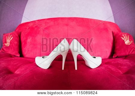 Wedding White Bridesmaid Shoes On The Red Sofa