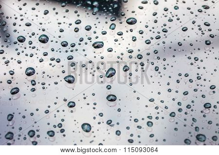 texture of raindrops on a car surface after raining