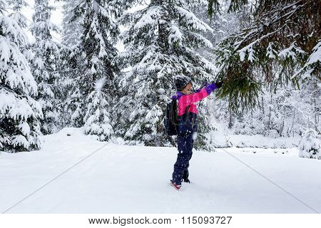 Girl hold a hand Christmas tree in the snow