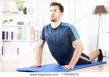 Fit Man Doing Press Up Exercise On A Fitness Mat