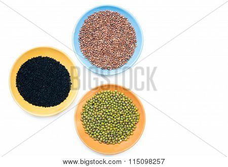 Three Bowls With Different Seeds On White Background