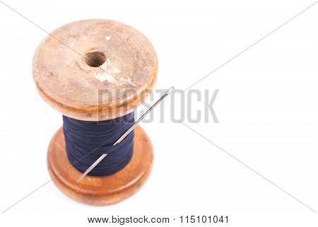 spool of thread with needle