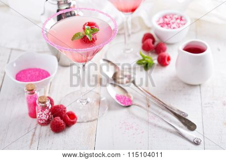 Raspberry martini on white table