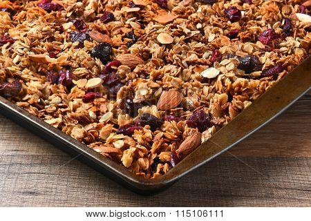 Closeup of a baking sheet full of homemade granola.