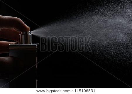 Spray Perfume On Black