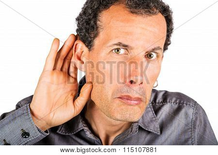 man cupping hand behind ear