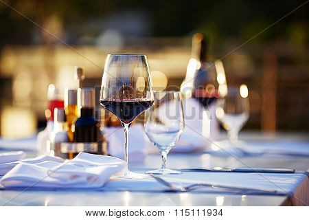 Glasses with red wine at sunset