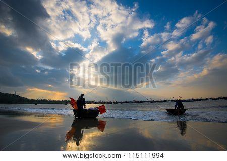 People work in sunrise in My Khe beach, Da Nang