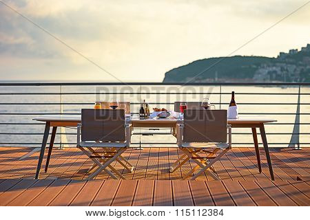 Table on the terrace at sunset