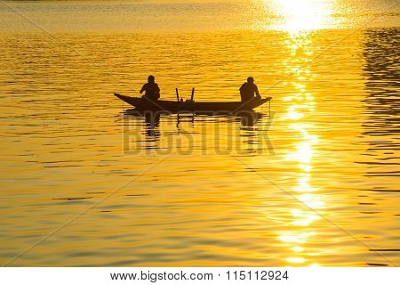 Fishermen on boat in Han river near Dragon River Bridge ( Rong Bridge) in sunset in Da Nang, Vietnam