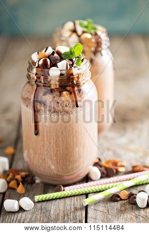 Chocolate shake with sauce and marshmallows