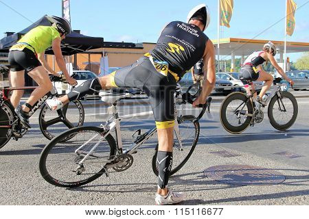 Men And Women Jumping Up On Professional Bicycle Racers