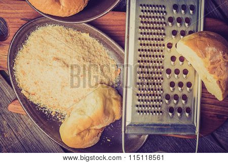 Vintage Photo Of Homemade Breadcrumbs On A Wooden Table
