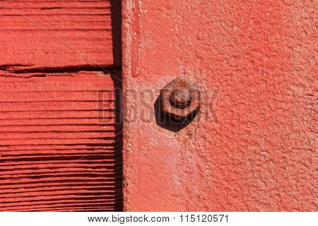 Red Grunge Nut And Bolt With Focus Only On One Nut