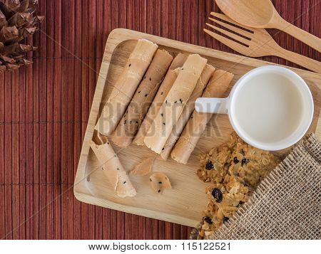 Thai Rolled Wafer And Cookie With Cup Of Milk In Wooden Tray