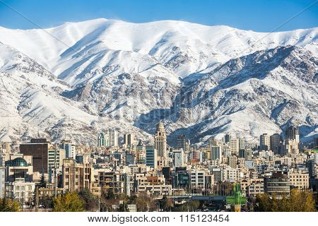 Winter Tehran  view with a snow covered Alborz Mountains on background