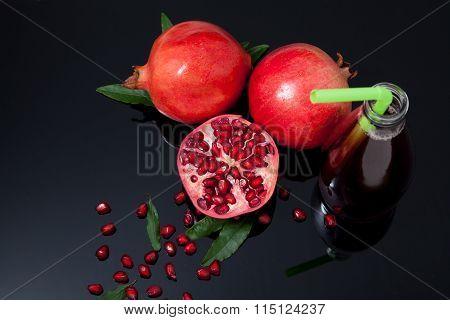 Isolated Pomegranate Juice With Pomegranate On Black Background