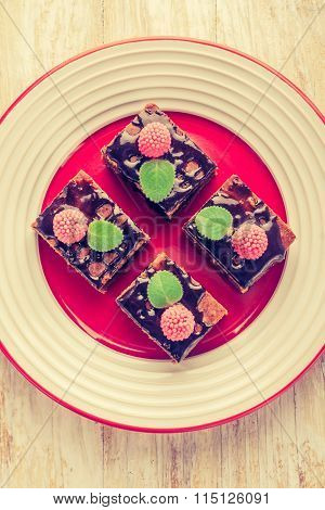 Vintage Photo Of Chocolate Cake With Raspberries And Fresh Mint.