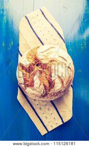 Vintage Photo Of Rustic Sourdough Bread On A Linen Cloth