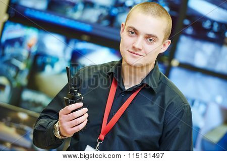 security guard officer with portable radio transmitter over video monitoring surveillance security system