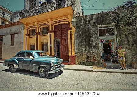 CUBA, HAVANA-JULY 10, 2015: Classic retro car rides through the streets of Havana.