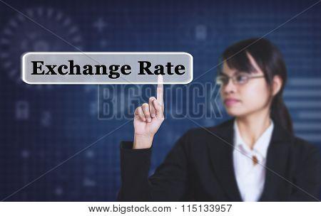 Businessman pressing a Exchange Rate concept button.