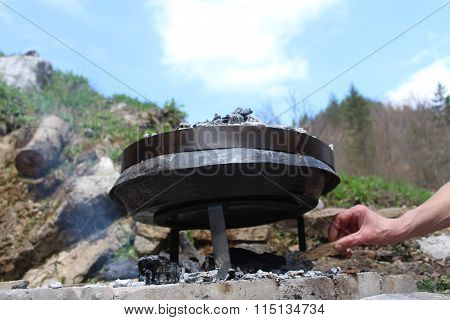 Preparing and Cooking of octopus in traditional Balkan Bosnian Mediterranean meal Peka in metal pots
