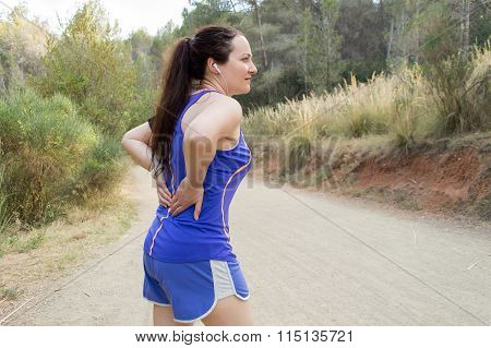Woman With Cramp On The Back
