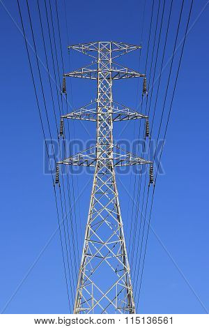 High Voltage Post. High-voltage Tower Blue Sky Background.