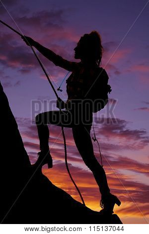 Silhouette Of A Woman Black Packer Climbing